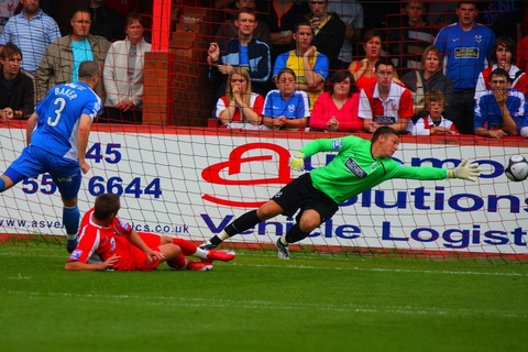 Dean Coleman, seen here in action during his Kidderminster Harriers days, is set to cross the A458 divide