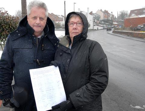 Neighbours Roger Thompson and Stella Rourke with the petition. (To buy:071328M)