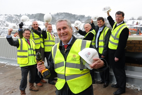 Councillor Steve Eling with Portway Centre partners Bill Munn, Ian Silvera, Simon Murphy, Richard Nugent, Andrew Dixon and Paul Slater.  A TOPPING out ceremony marked another milestone in the development of a £18 million health, leisure and well-being ce