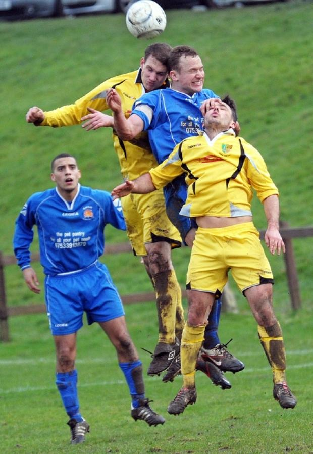 Chris Waterhouse (blue) battles against Bodmin