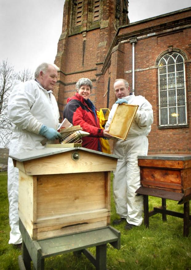 Rev Katryn Leclezio with beekeepers Nick Bromfield and Doug Cooley. 111323L.