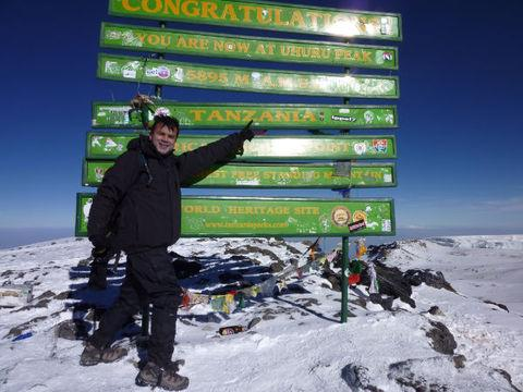Dinesh Patel at the summit of Kilimanjaro.