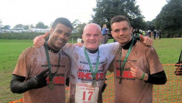 Winners: Simon Akufo, trainer Paul Murphy and son Lewis at the Commando Challenge