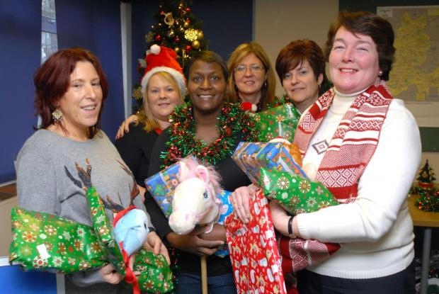 Halesowen News: Festive hope: (from left) Centre volunteer Camilla Phillips, with housing support officer Hannah Mason and helpers Wendy Riley, Tina White, Sharon Wright, and Cllr Jill Nicholls (Buy photo: 501348M )