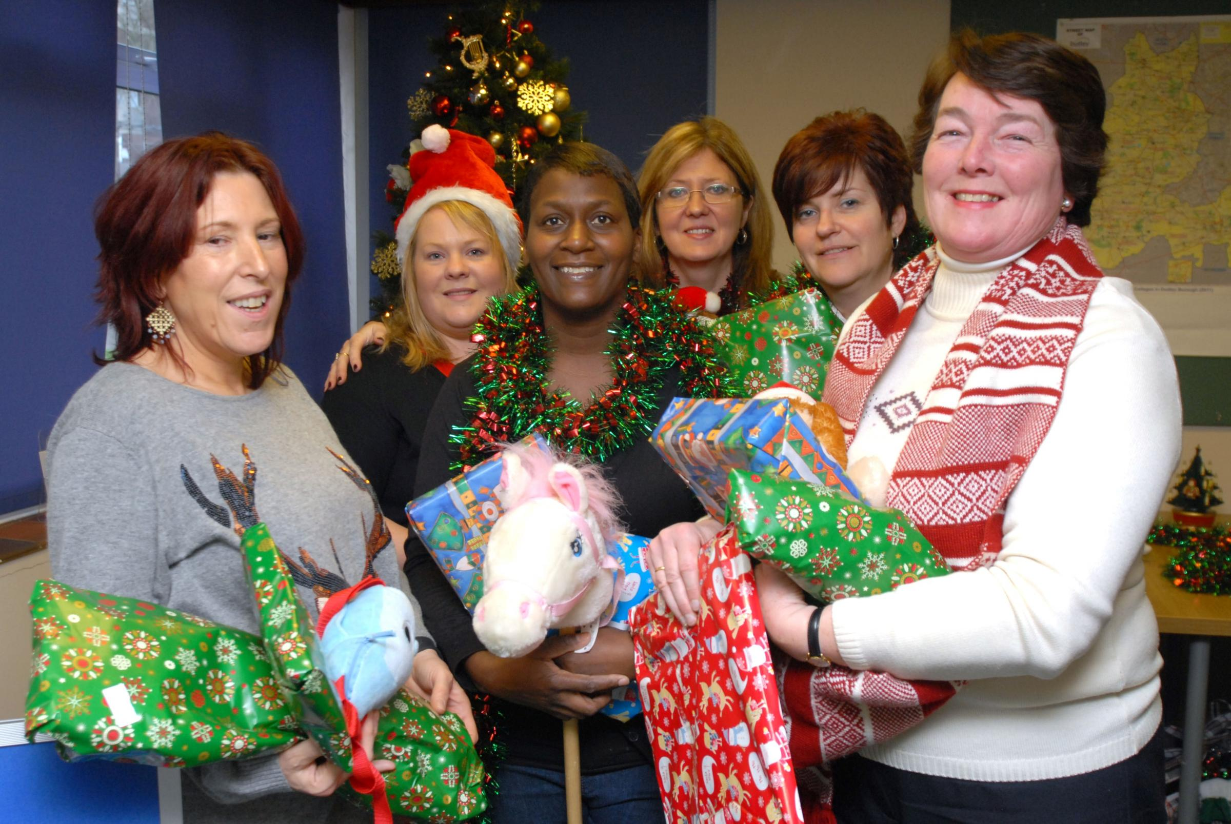 Festive hope: (from left) Centre volunteer Camilla Phillips, with housing support officer Hannah Mason and helpers Wendy Riley, Tina White, Sharon Wright,