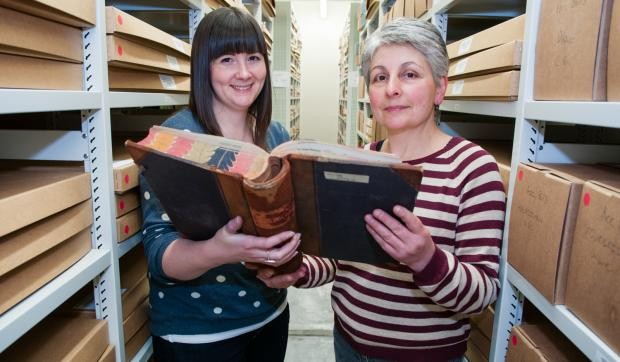 Assistant archivist Helen Donald, left, with archives assistant Elaine Nicholson, right, in the new centre's strong room.