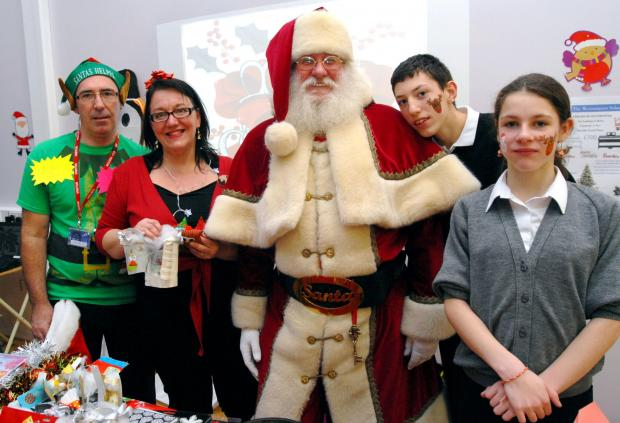 PTA members Kim Yeomans and Vicki Smith, with Santa, and pupils Thomas Sandall, aged 15, Jody Edwards, aged 13. (Buy photo: 521306M )