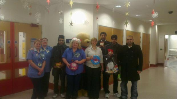 Ahmadiyya Muslim Youth Association volunteers at Russells Hall Hospital children's ward.