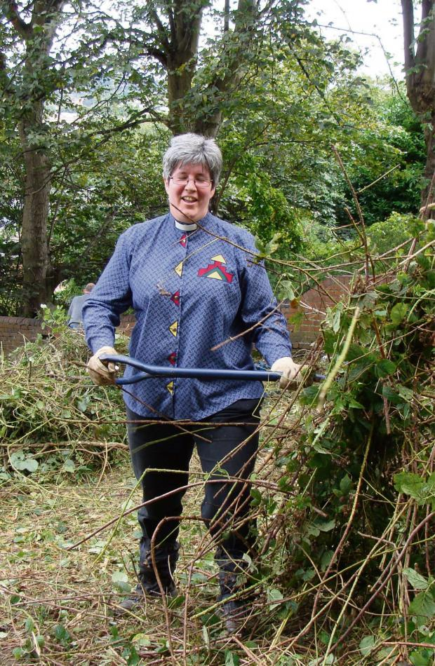 Halesowen News: Reverend Katryn Leclézio clearing the orchard