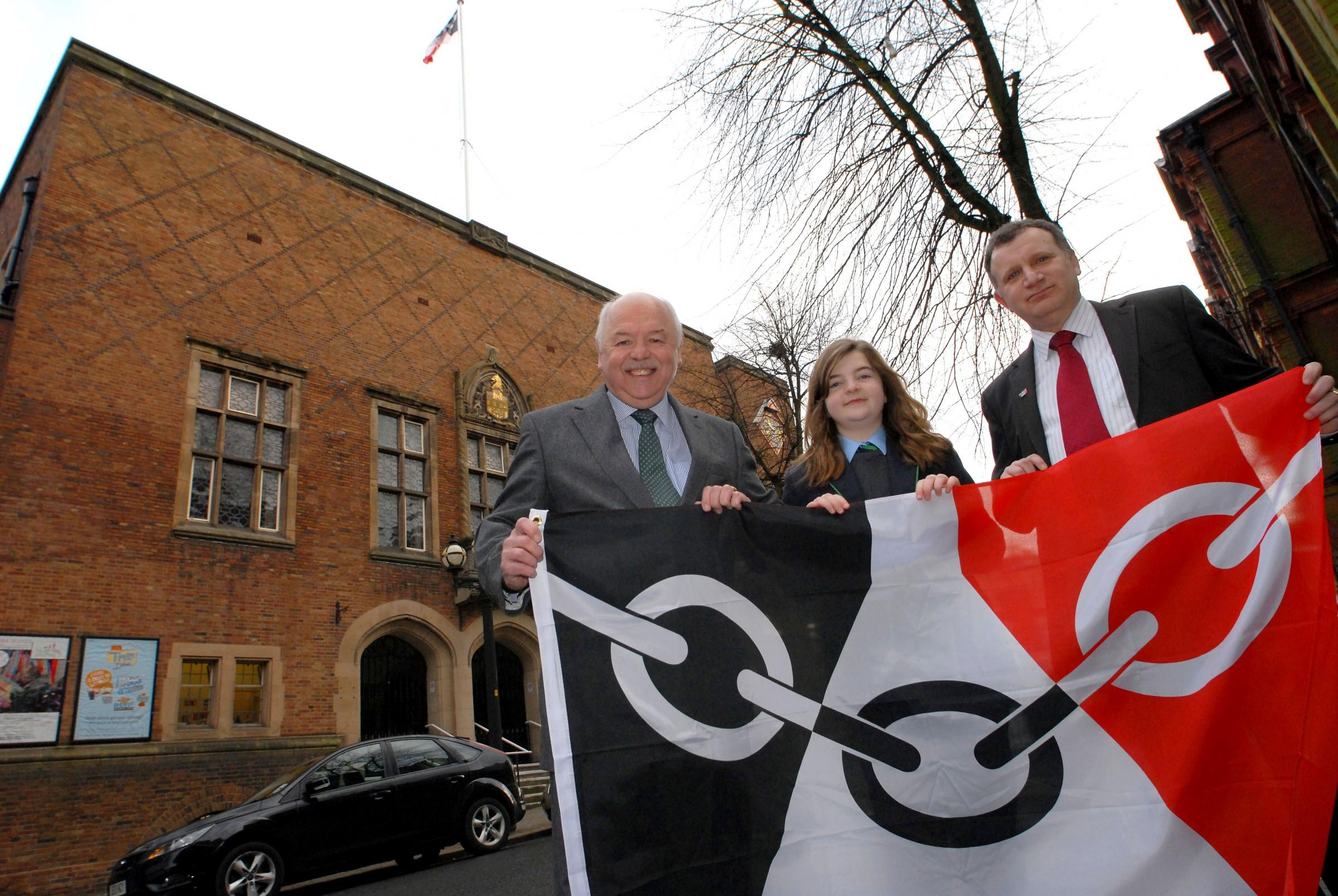 Dudley council leader, cllr David Sparks with Redhilll school pupil Gracie Sheppard who designed the Black Country Flag and Dudley deputy leader, cllr Pete Lowe