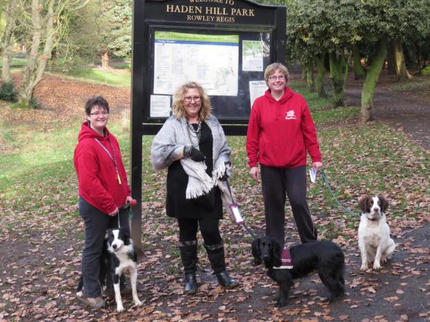 Denise Dodd, (centre) from Hearing Dogs for the Deaf with Paddy and Liz Hancock (left) and Kim Wilkes from the Haden Hill Dog Awareness Group.
