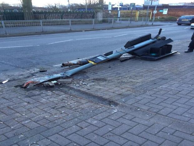 The damaged lamp post at the scene of the crash (picture by West Midlands Police)