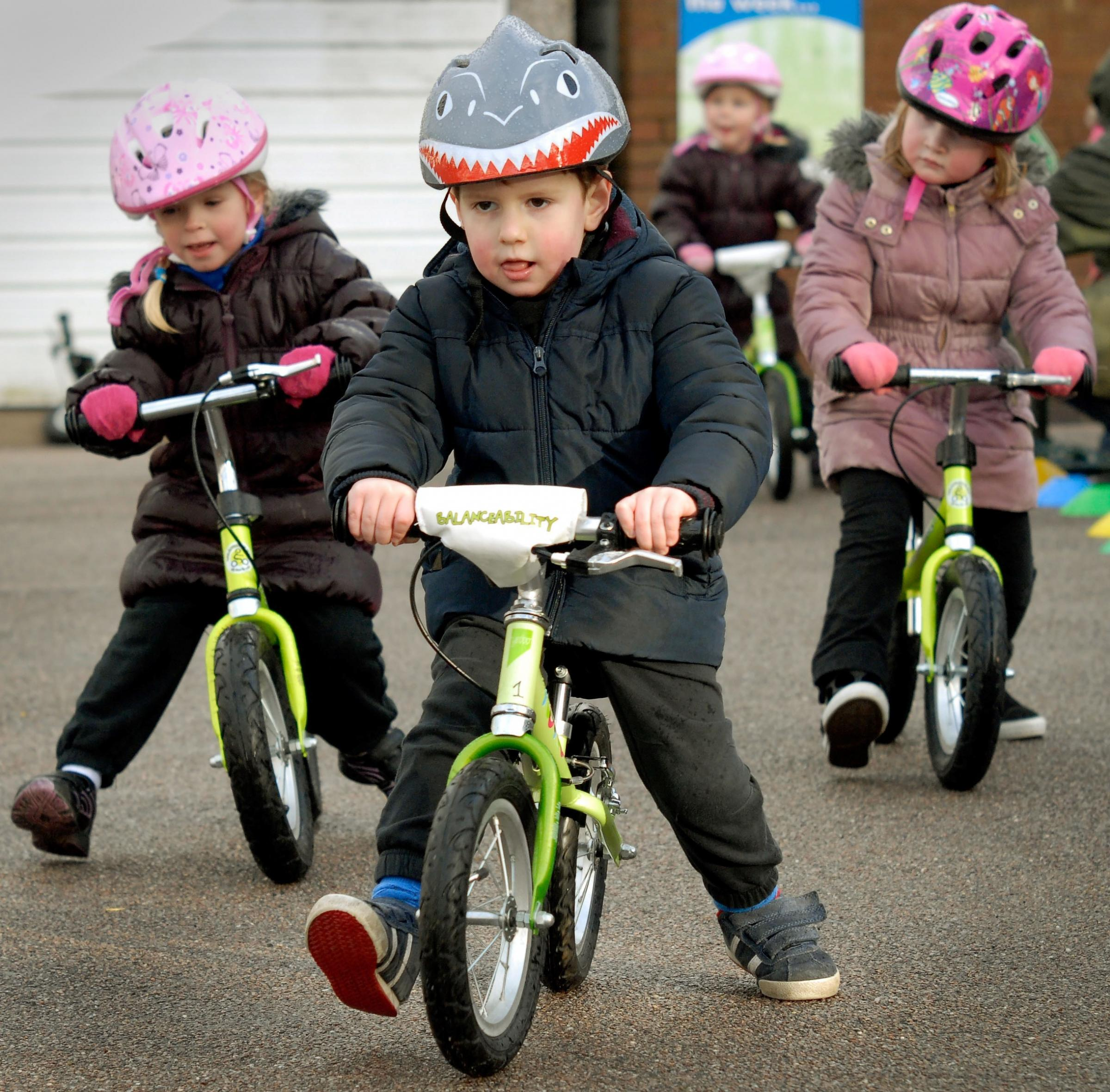 Wheely good fun! Elisa Fletcher, Charlie Green and Maisie Tapping on the new balance bikes. (buyphoto 4325819)
