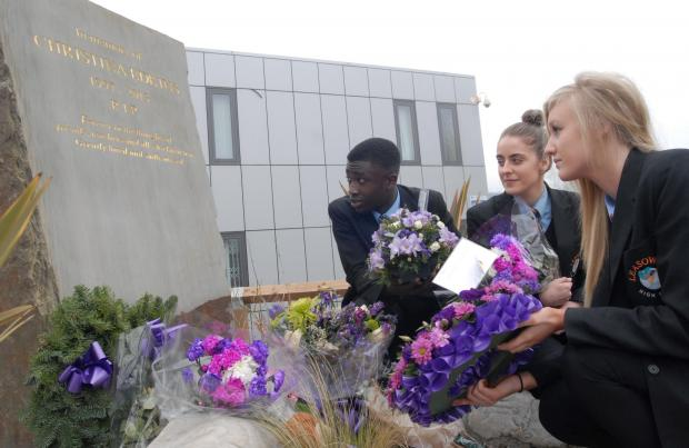 Leasowes students (from left) Dariess Davy, Leah Downes and Emily Blakeway , all aged 16,  lay tributes at Christina's memorial in the school grounds.