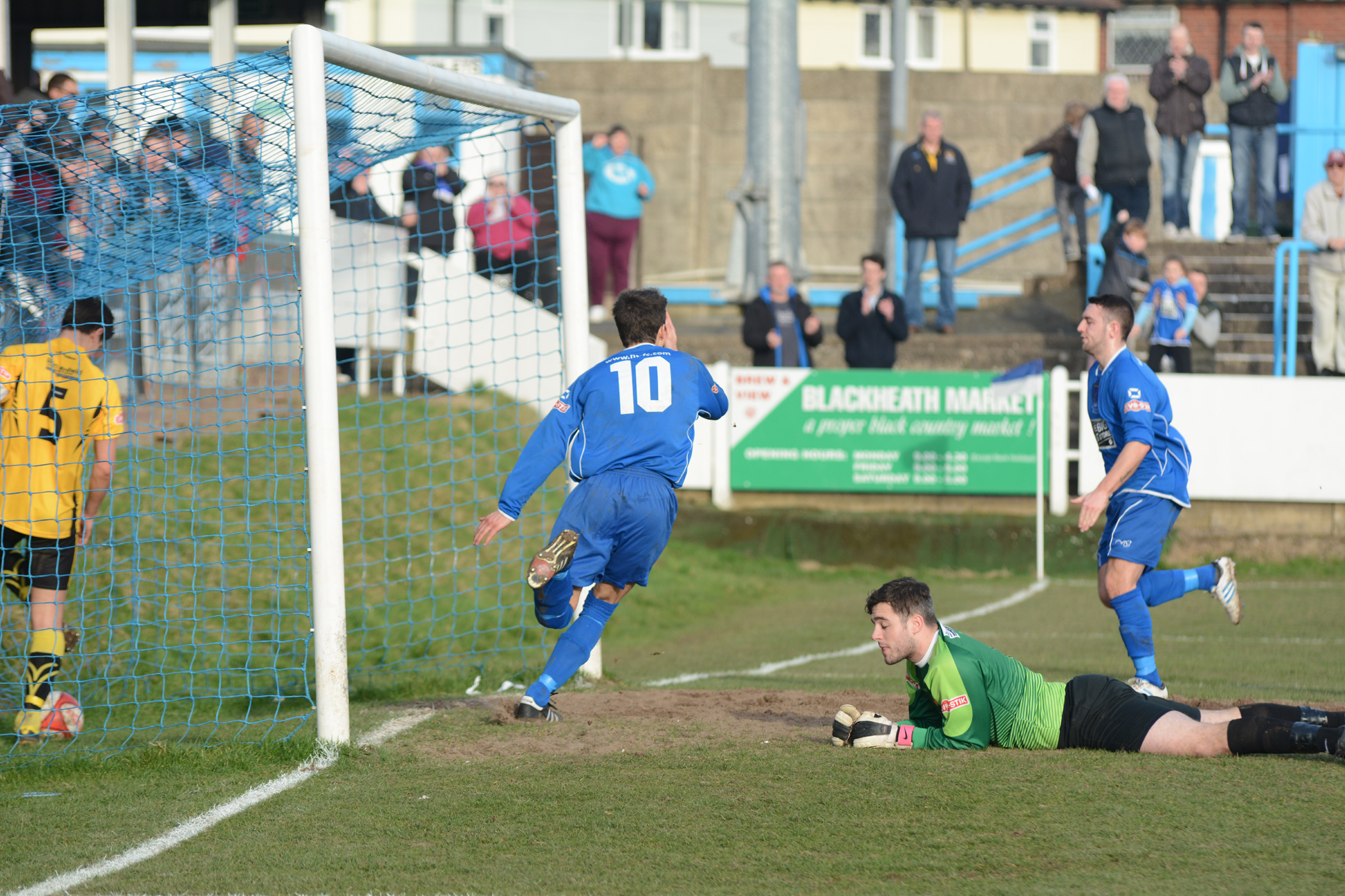 Halesowen's Ben Haseley wheels away after scoring against Belper.