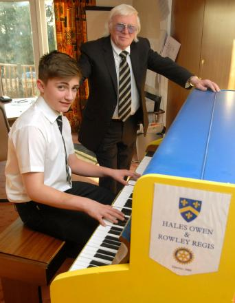 Tony Billingham with grandson Henry Liggins striking a chord on the Rotary piano.