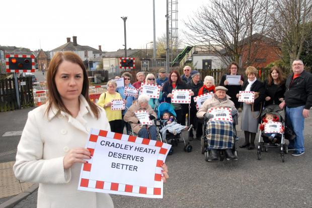 Stephanie Peacock with furious residents who want Cradley Heath's level crossing reopened.