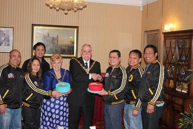 Filipino basketball players swap the court for the Mayor's parlour