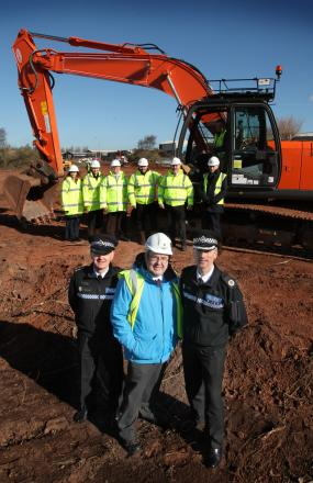 Police and crime commissioner Bob Jones with offers and construction workers at the Oldbury cell block site