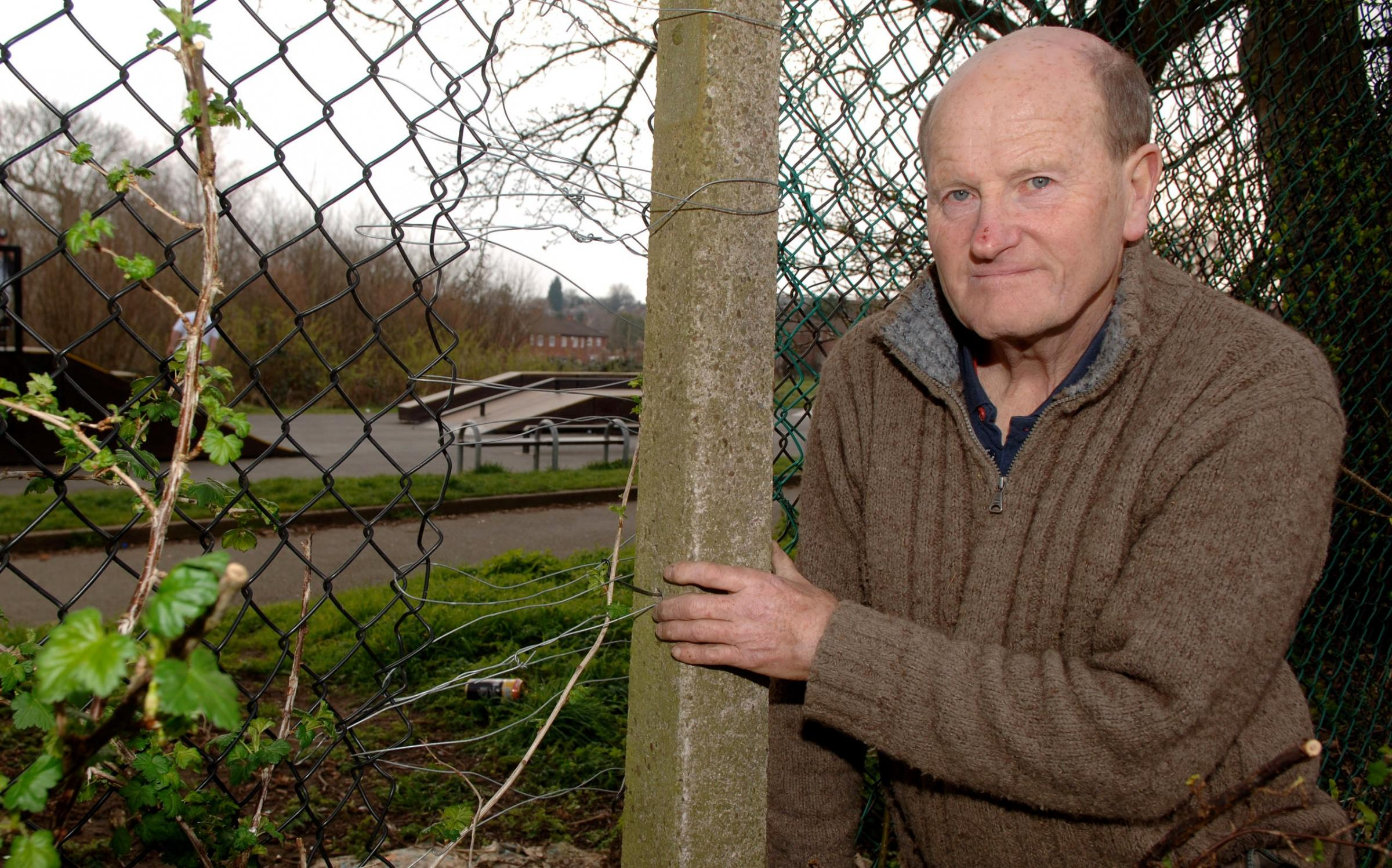 Allotment chairman Dave Adams with the broken fence.