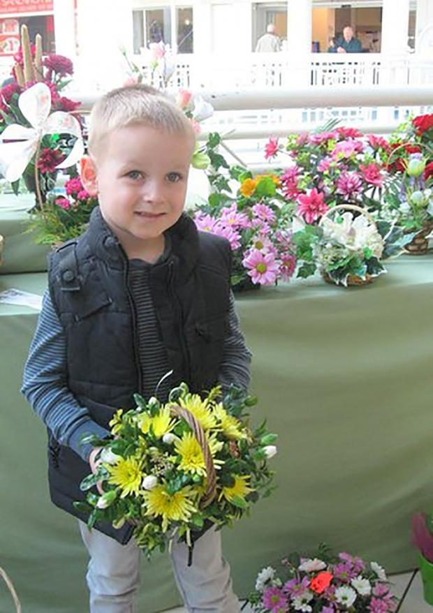 Halesowen News: Layton Harris with some flowers for his mum.