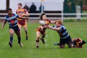 Harry Bayliss offloads to Donavan Smile during DK's loss to Sedgley Park. Photo: Ian Jackson