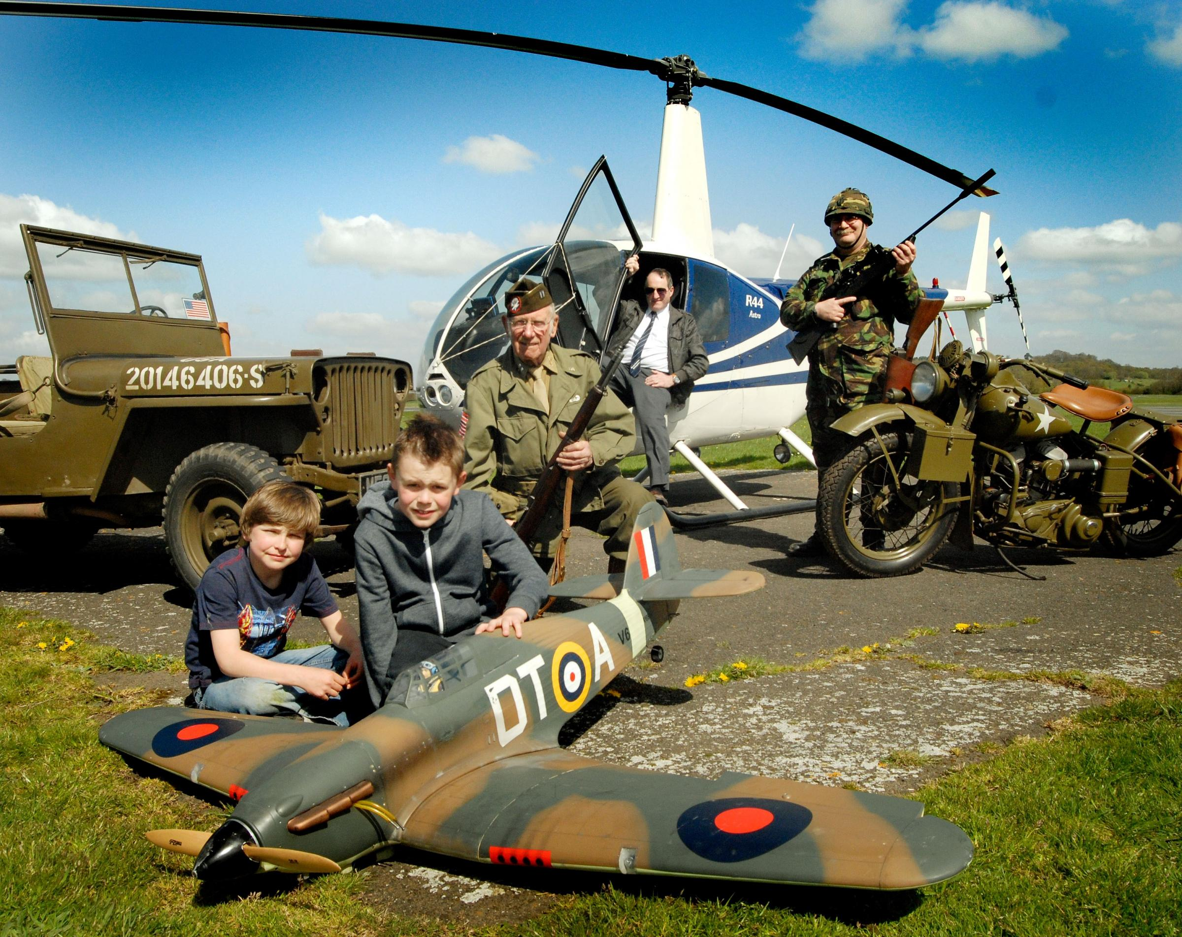 Josh Richards (10) and Henry Burton (9) with a model Hurricane fighter, John Vaughan, Roy Targonski and Richard Currinn. Buy this photo: 161426