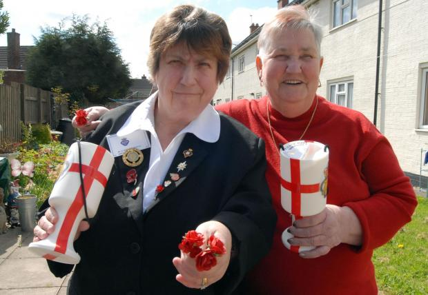 Ex-army wives Shirley Eades (left) and Ellen Sigley with the red rose buttonholes .