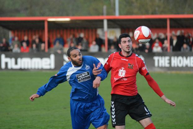 Iyseden Christie competes for the ball against Sheffield. Photo: Dave Hawley
