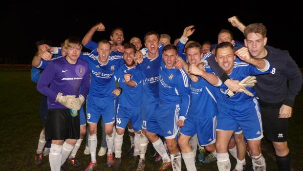 The Lye players celebrate winning a league and cup double