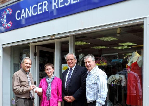Shop manager Jean Shaw with choir members (from left) Colin Foxall, Stephen Bradley and Bill McBain.