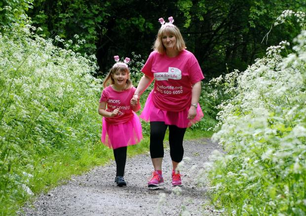 Karen Garrison and daughter Lucy, aged seven, prepare for the Race for Life.