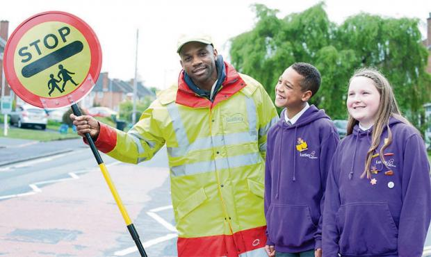 Ashleigh Legge and Isaac Gould, both aged 11, from Lutley Primary School with lollipop crossing patrol Paul Mullings.