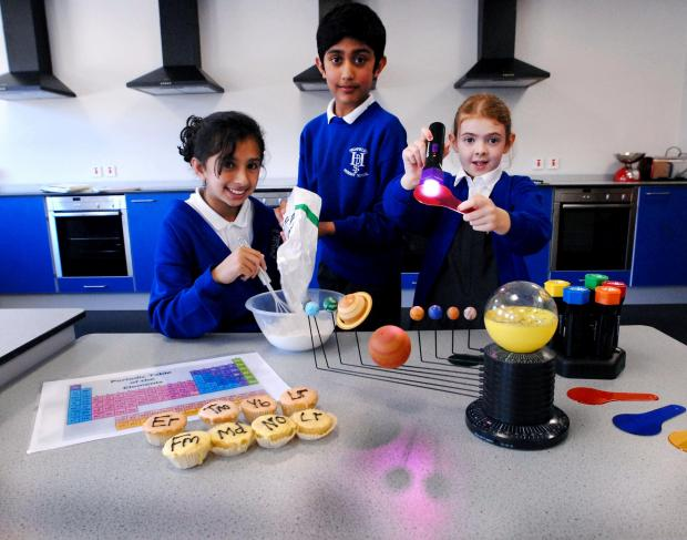 Highfields pupils (from left)  Sidra Masoud, aged 10, Qasim Farooq, aged 11, and  Sophie Ibbottson-Pitt, aged nine, explore their new Discovery Den.
