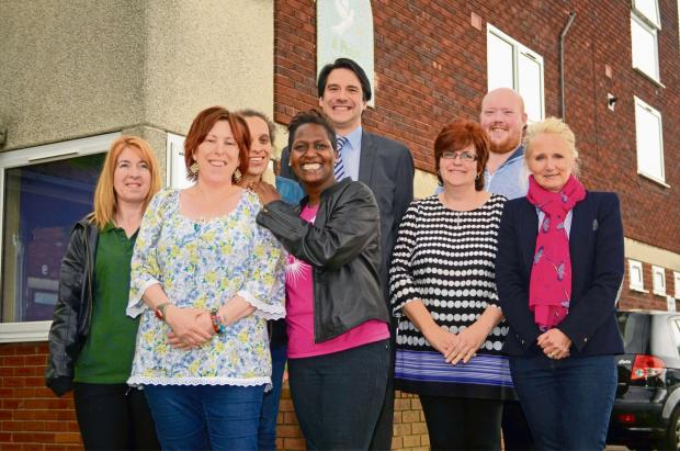 Royal stamp of approval: James Morris MP with Hope Centre volunteers