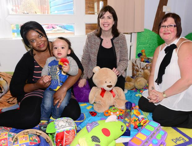 Happy Faces, (from left) Kylie McCaulsky and son Jenson with shadow minister for childcare and children Lucy Powell, and children's centres cluster manager Paula Ralph.