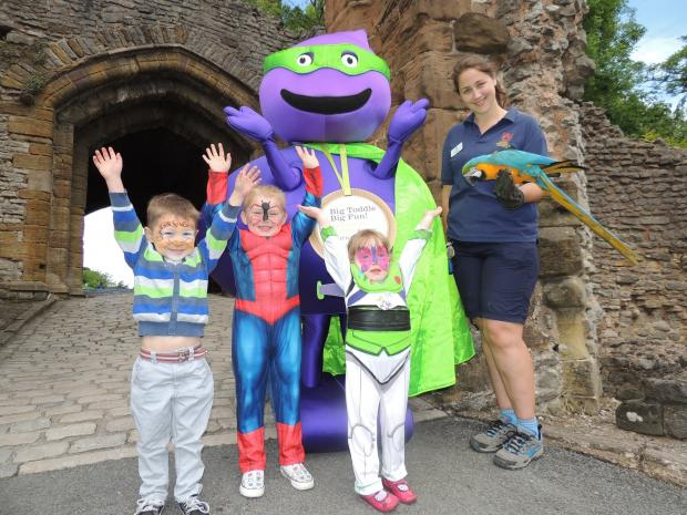 Cameron Abraham (4), Riley Millington (4) and Katie Jones (3) at the Big Toddle with Barnardo's mascot Tod, DZG presenter Pam Midwood and blue and gold macaw, Charlie.