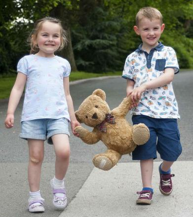 Hannah Coton, aged four and Zacharia Perry, aged three, from Halesowen, prepare for Bring a Bear Day