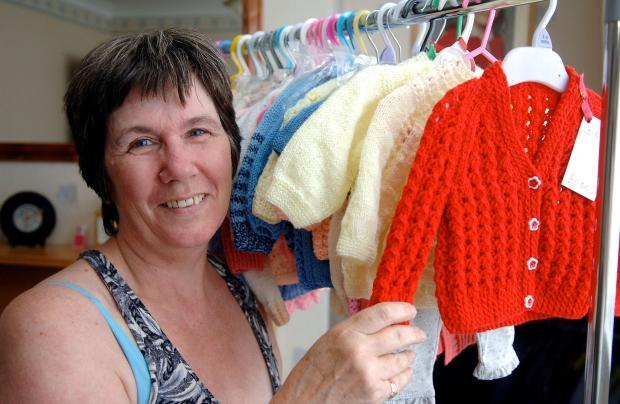 Fundraiser Jill Ditchfield with some of her baby knitwear.