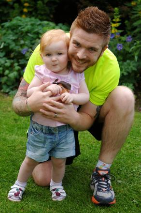 Scott Mitchell and and one-year-old daughter Poppy.