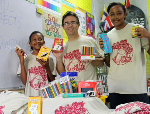 Ted Todd, pictured with Cayman Island students Taejsha Ramoon and Latoiya Webb, packing for his charity road trip.