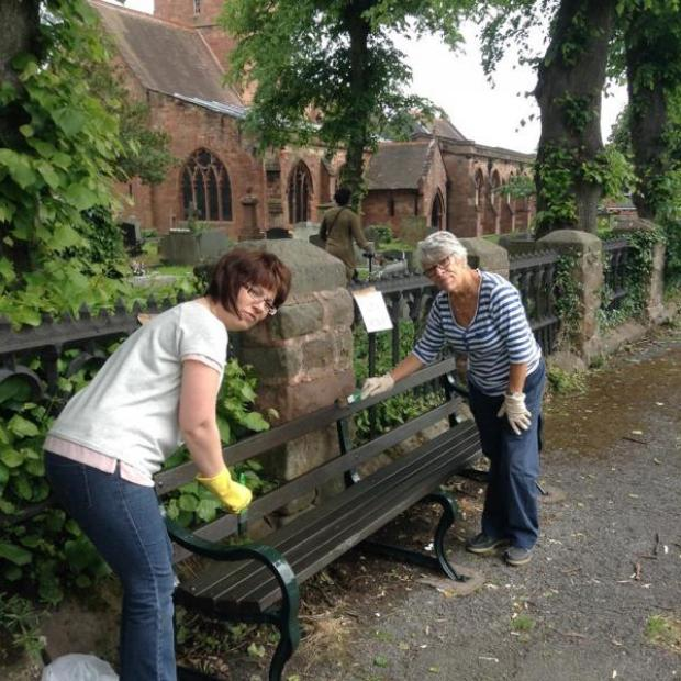 Halesowen News: Volunteers Nicky Bench (left) and Margaret Breen painted three benches outside St John's Church.