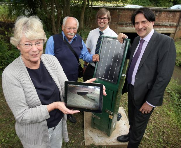 Halesowen News: Halesowen resident Maureen Reeves, Illey Brook Flood Committee founder Claude Mosseri with Environment Agency project officer Jamie Sarginson and James Morris MP.