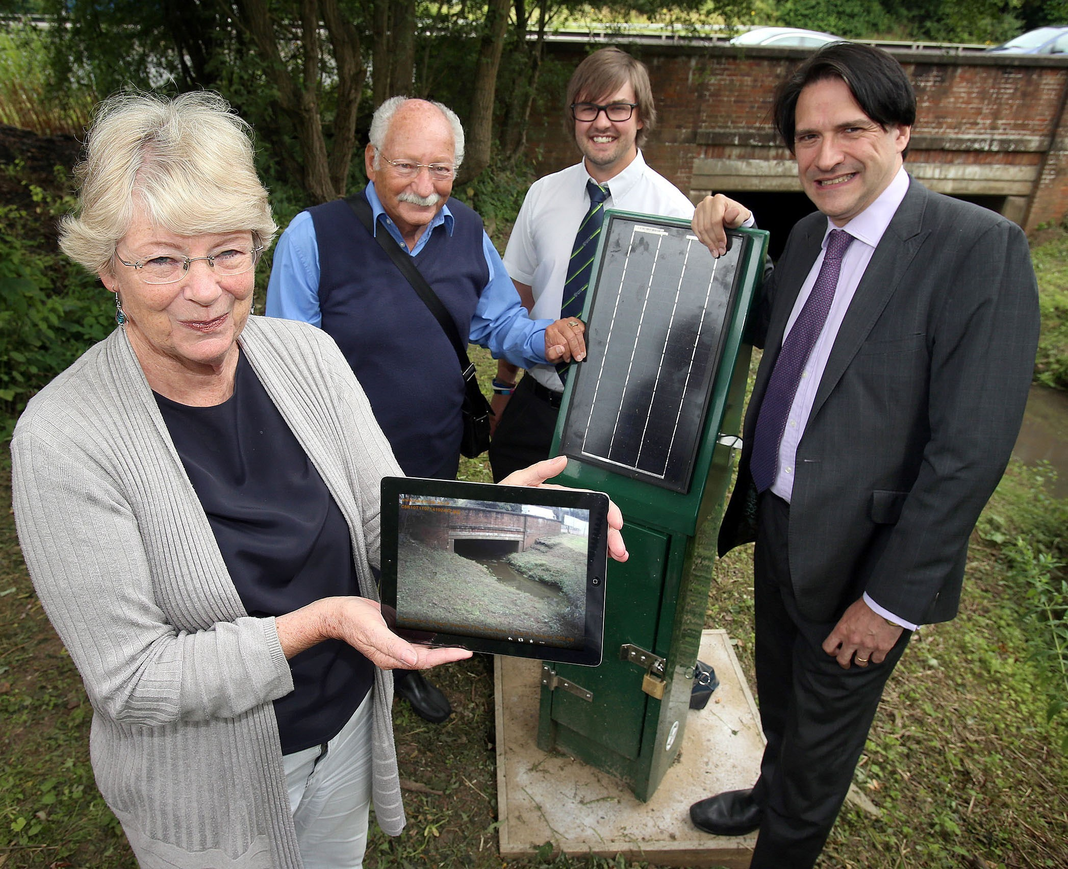 Halesowen resident Maureen Reeves, Illey Brook Flood Committee founder Claude Mosseri with Environment Agency project officer Jamie Sarginson and James Morris MP.