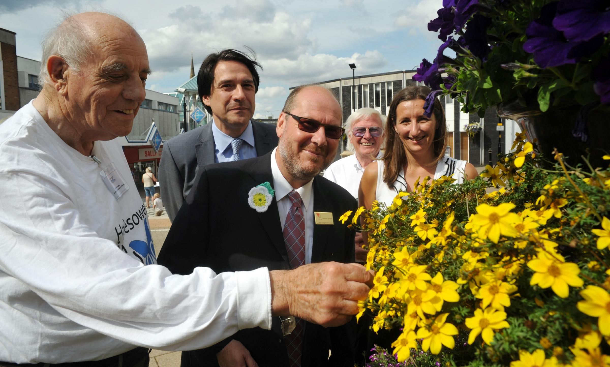 Blooming lovely: John Young, James Morris MP, Heart of England in Bloom judge Graham Redfern, Tony Billingham and Eve O'Connor in Somers Square.