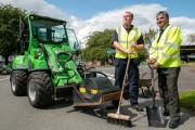 Roadworker Liam Bryant and Councillor Khurshid Ahmed get to grips with the new pothole mending equipment