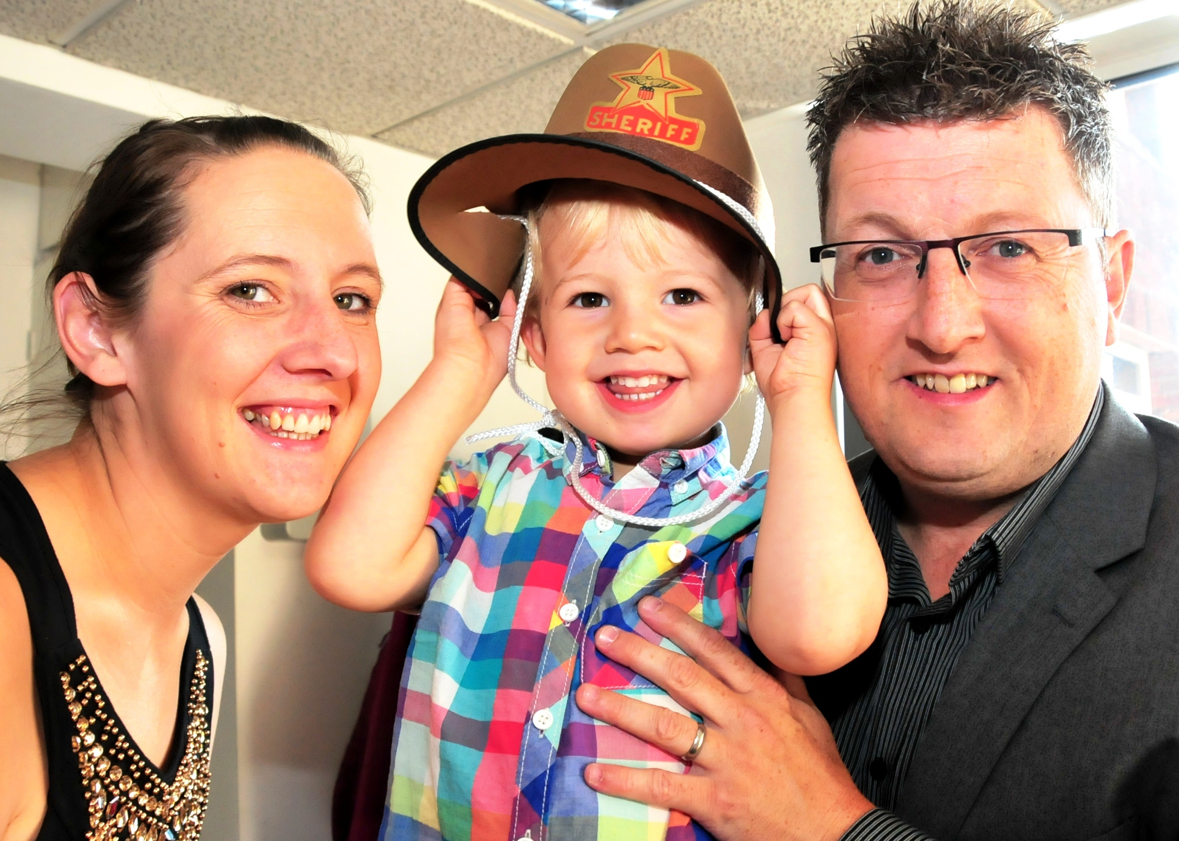 Halesowen fundraising youngster Fin Carpenter with his parents Darren and Lucy.