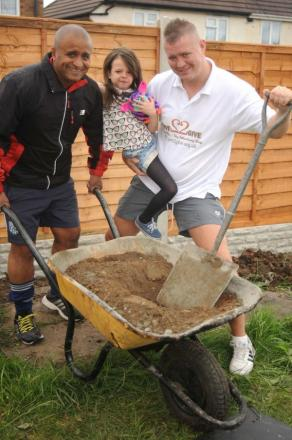 Mia Bowden, aged eight, with volunteer Bal Singh, (left) and Pete Jackson from Love2Give at the start of the garden makeover.