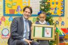 Christmas card winner Mia Simpson with James Morris MP.