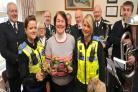 Volunteer Jill Nicholls with PCSO's Selina Jasper and Beth Cooper and members of Cradley Heath Salvation Army band.